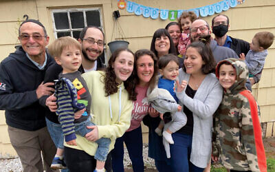 Celebrating their 15th grandson's 1st birthday. Pictured from left, Richard Gertler, Alex Sterman, Koby Sterman, Eva Silverman, Nitzana Silverman, Grandma Ellen Gertler, Beverly Gertler, Sarina Gertler, Ari Silverman, David Gertler, Evan Gertler, and in front Benny Sterman, Shlomit Sterman, and Asher Silverman.