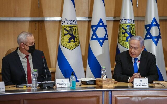Israeli Prime Minister Benjamin Netanyahu, right, and Defense Minister Benny Gantz at the weekly Cabinet meeting, at Jerusalem City Hall, May 9, 2021. (Amit Shabi/POOL)
