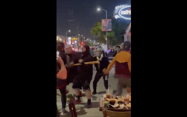 Pro-Palestinian demonstrators are captured on cellphone video physically attacking Jews and using antisemitic language at a restaurant in Los Angeles, May 18, 2021. (Screenshot)