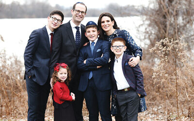 Sari Sheinfeld with her family; from left, Eytan, Yaakov, Binyamin, Sari and Yonah. Leora is in front.