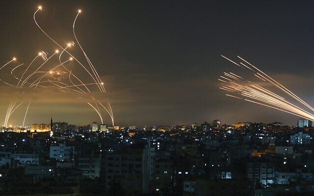 The Iron Dome interceptors, coming from the left, meet a volley of missiles from Gaza on May 14, 2021. (Anas Baba/AFP via Getty Images)