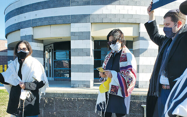 Rabbi Rachel Kahn-Troster, left, protests outside the Bergen County jail in Hackensack in November 2020 with a T'ruah group that also includes Rabbi Mira Rivera of Romemu in Manhattan and Rabbi Jesse Olitzky of Congregation Beth El in South Orange. They were demonstrating their solidarity with hunger striking prisoners.