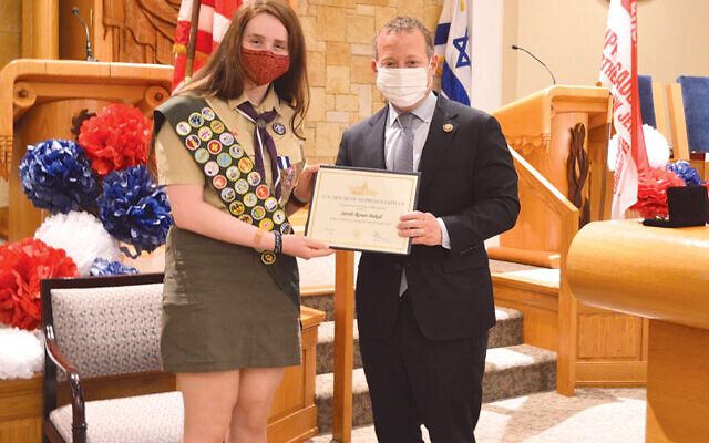 Congressman Josh Gottheimer presents Eagle Scout Sarah Renee Bakal with a congressional certificate of recognition at her Court of Honor inside Temple Israel of Ridgewood on May 23.