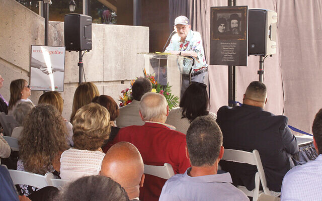 Alan Moskin, a camp liberator, speaks at the opening.