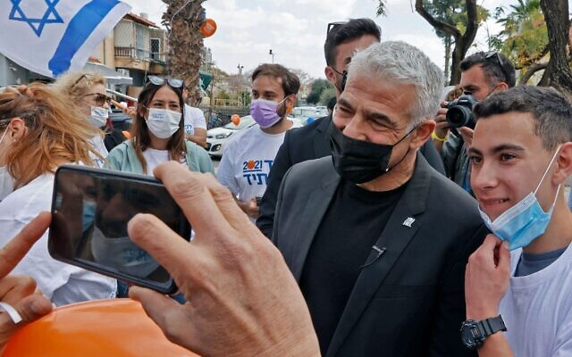 Yair Lapid, chairman of the opposition Yesh Atid party, campaigns in the Israeli coastal city of Hod Hasharon, March 19, 2021. (Jack Guez/AFP via Getty Images)