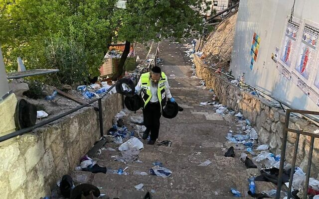 A volunteer with the ZAKA response group walks through the debris left in the aftermath of the stampede in Meron, Israel, April 30, 2021. (ZAKA/Aharon Baruch Leibowitz)