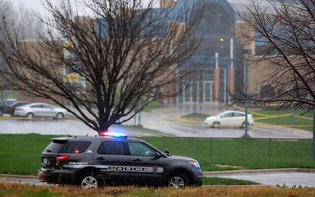 An Overland Park police vehicle sits in front of the Jewish Community Center of Greater Kansas City, Kan., following shootings there and later at a nearby assisted-living complex that killed a total of three people, April 13, 2014. (Jamie Squire/Getty Images)