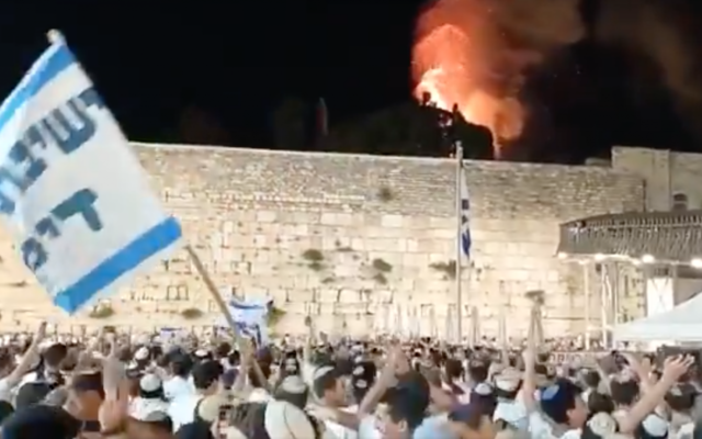A video of Israeli men at the Western Wall singing and dancing as they watched a fire burn outside the Al-Aqsa Mosque has gone viral during the conflict. (Screen shot)