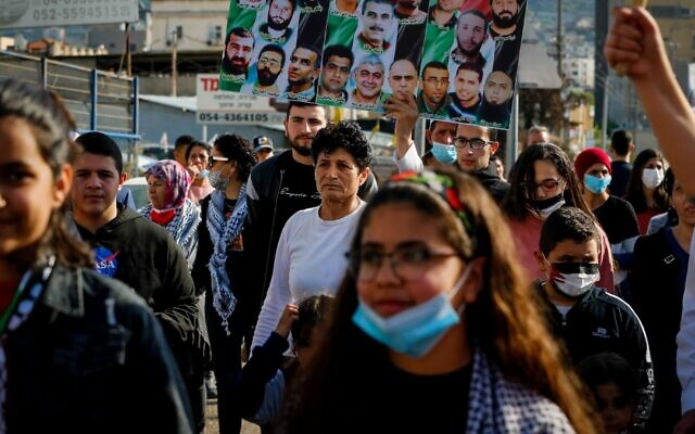 Israeli Arabs participate in a protest in March 2021. (Jamal Awad/Flash90)