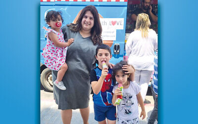 One of the many families that enjoyed ice cream courtesy of donors to Chabad of Hackensack. (Courtesy Chabad)