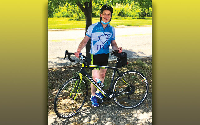 Jamie Janoff, representing Team Jewish Standard, stands by his bike at last year's ride.