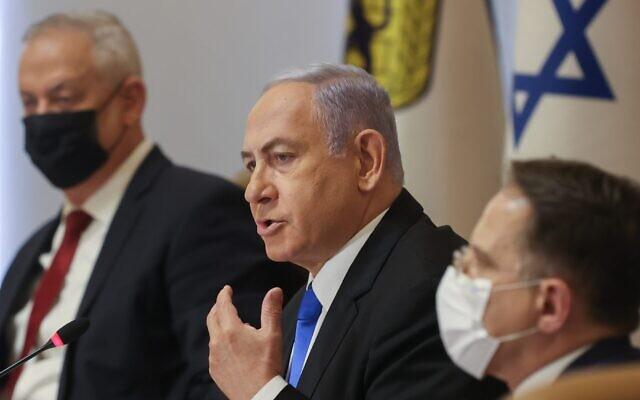 Israeli Prime Minister Benjamin Netanyahu, center, and Defense Minister Benny Gantz, left, at a Cabinet meeting in Jerusalem, May 9, 2021. (Amit Shabi/Pool/Flash90)
