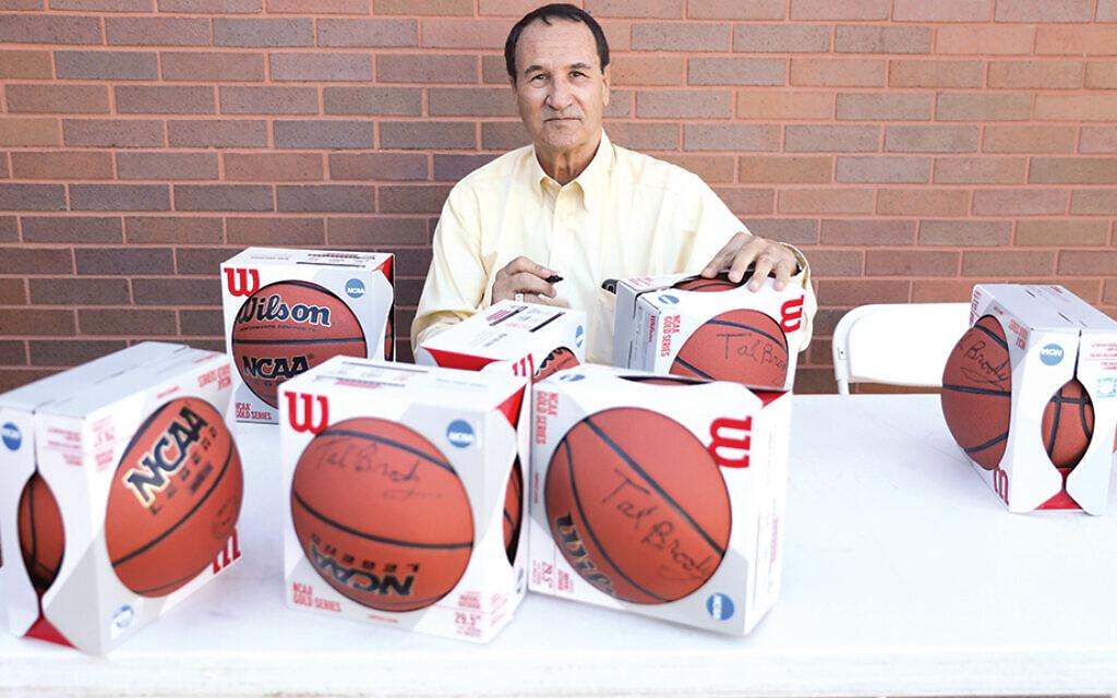 Tal Brody signs basketballs at the JCC.