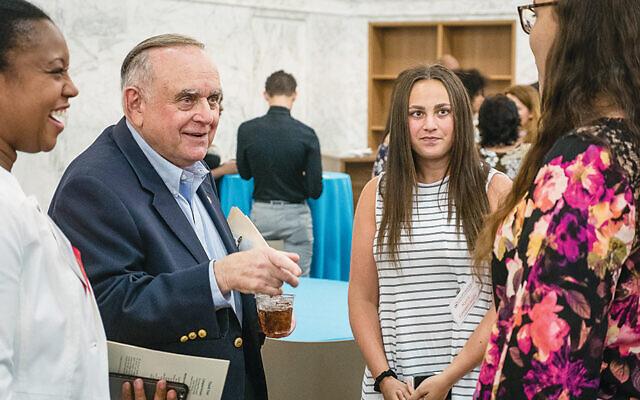 Leon Cooperman talks with some Cooperman College Scholars.