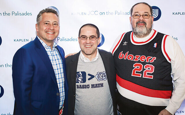 JoJo Rubach and Jeff Levitt, co-chairs of the annual Sports Night of Champions, with the Jordan Shenker, the JCC's CEO. (Photos courtesy JCCOTP)