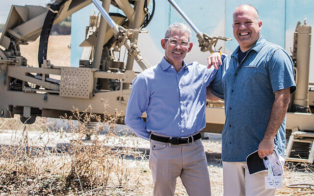 Lee Lasher, president of the Jewish Federation of Northern New Jersey, and Jason Shames, the federation's CEO, pose in front of a Iron Dome missile defense battery outside Ashkelon.