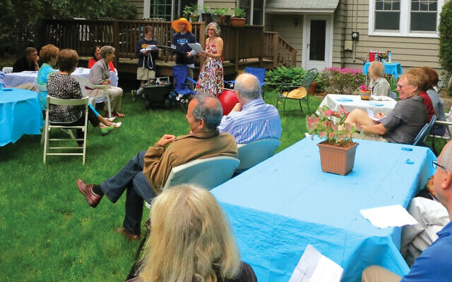 Merrill Silver's husband, Andy, turned 60 at this party; that's Merrill in the flowered dress.
