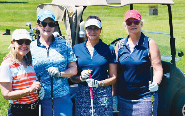 Lauri Bader and Fran Weingast, left, and Cheryl Black, right, golf with  Community Chest board member Barbara Brensilber. (Photos by Samuel Lee)