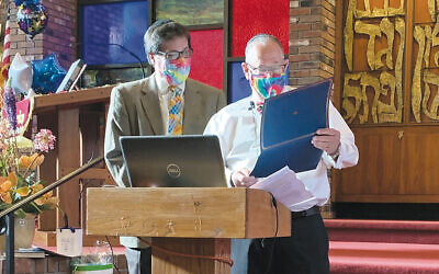 Outgoing JCCP/CBT president Wayne Zeiler, left, with incoming president, Rob Chananie. (Sandra Alpern)