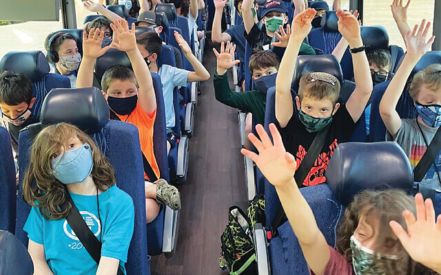 These excited campers are on their way to Camp Young Judaea Midwest in Waupaca, WI, this summer. (Foundation for Jewish Camp)