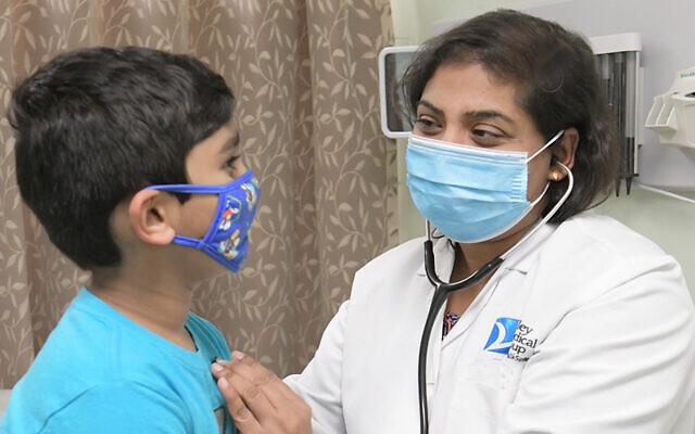Dr. Prabhavathi Gummalla with a patient.