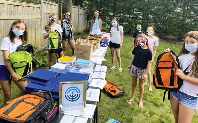 Sophie Conen of Demarest, right, holding an orange backpack, and friends.