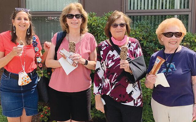 Lori Cohen, left, of Hillsdale, sisterhood co-president, with former  sisterhood presidents Ruth Smith and Phyllis Glatzer; and Millie Lerman, all of Paramus. (Sandra Alpern)