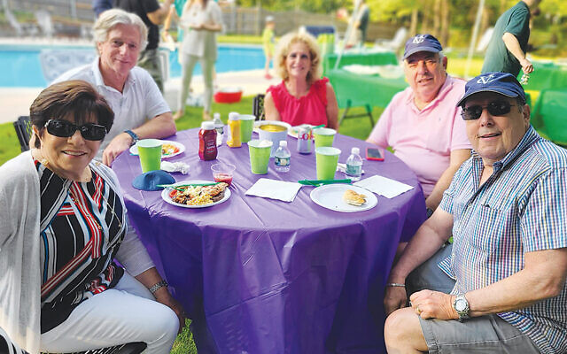 Rochelle and Tom Goldberg of Woodcliff Lake, left, with Barbara and Richard Baum of Montvale, and Jeff Davis of Woodcliff Lake. (Valley Chabad)