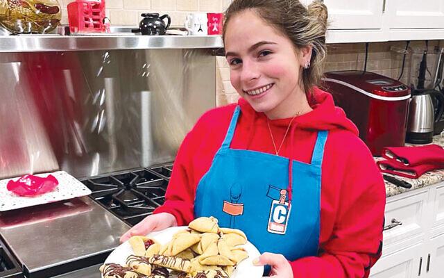 Maya Resnick of Montvale baking at a previous virtual CTeen baking program. (Courtesy Chabad)