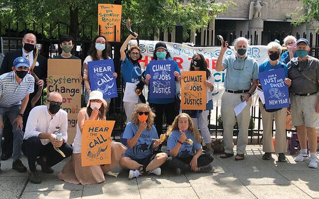 New Jersey Dayenu rallies in front of Newark's Penn Station.