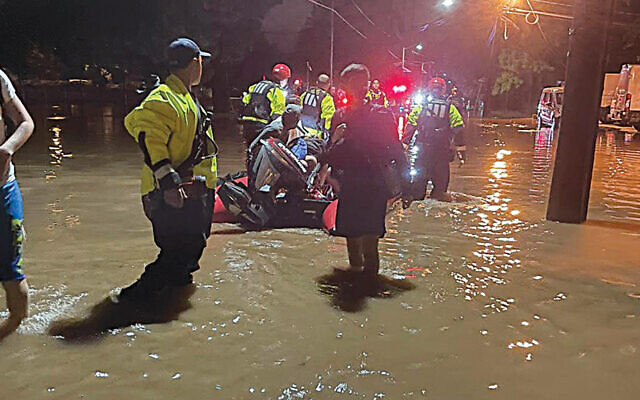 Emergency rescuers come to the aid of the students of Englewood's Yeshiva Ohr Simcha on the night of September 1 as water flooded dormitory rooms and the parking lot. (Photos courtesy  Yeshiva Ohr Simcha)