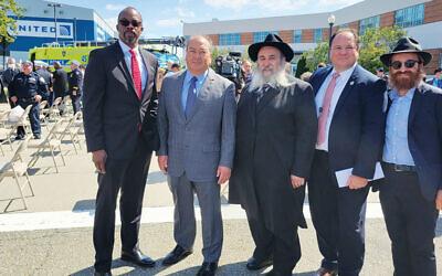 Huntley Lawrence, left, with Kevin O'Toole, Rabbi Mordechai Kanelsky, James Gill, and Rabbi Avremy Kanelsky.  (Courtesy Bris Avrohom)