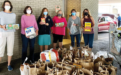 Rima Rosenstein, Karen Blick, Michele Wellikoff, Beth Chananie, Sandy Alpern, and Lili Baumzweig are shown with some of the many pantry donations.