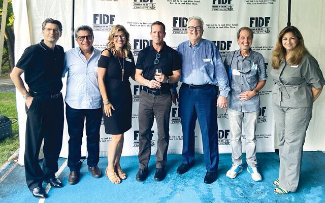 Steve Weil, left; with national board member Sammy Bar-Or, Orna Sheena, Major General (Res.) Nadav Padan, Howard Gases, Mel Berger, and Galit Brichta. (Jackie Wertman, FIDF)
