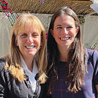 Elana Silber, Sharsheret's chief executive officer, and Jordana Altman, its director of marketing and communications, also were at the lunch in the Holy Name sukkah. (Jeff Rhode)
