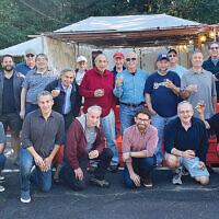 """The Glen Rock Jewish Center Men's Club held its annual """"Steak and Scotch in the Sukkah"""" dinner. The group toasted the new year with single malt scotch and a steak dinner in the sukkah. (Courtesy GRJC)"""