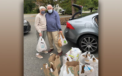 Volunteers from Wayne's synagogues, Shomrei Torah and Temple Beth Tikvah, bring their High Holiday collections to the Wayne Interfaith Network. (Courtesy WIN)