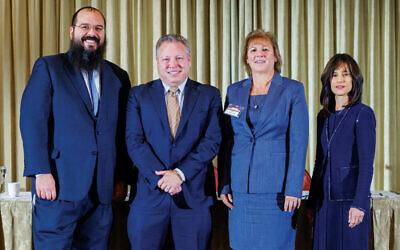 Rabbi Shalom Lubin, left, with Warren Usatine, Christine Amalfe, and Hon. Rachel Freier.Courtesy Rabbinical  (College of America)