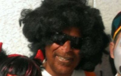Dov Hikind wearing blackface as part of a Purim costume in 2013.