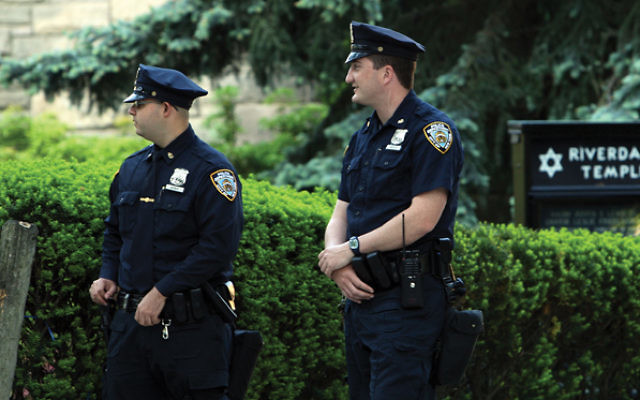 NYPD officers stand guard over a Riverdale Temple in the days after a 2009 bomb plot was foiled.  Getty Images