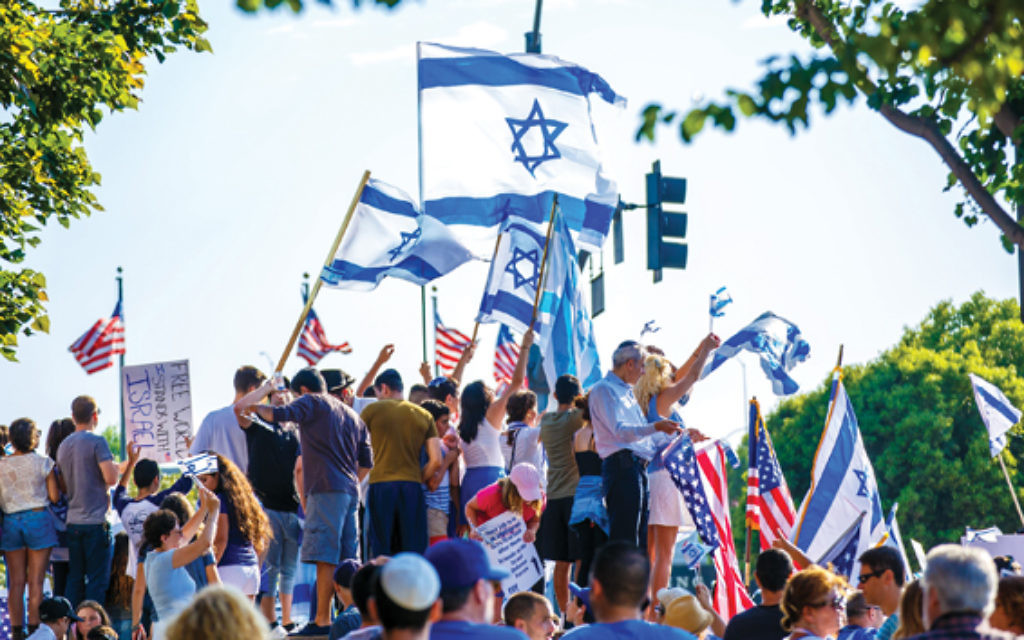 Members of Israeli-American Council chapter in Los Angeles hold a pro-Israel rally. IAC