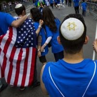 A participant marches in the Celebrate Israel Day parade in N.Y.C. in 2016. Relations between Israeli and American Jews has seen a growing rift lately. Getty Images