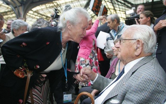 Sir Nicholas Winton is greeted by one of the 669 now-grown children he had rescued from Nazi-annexed Prague. Getty Images
