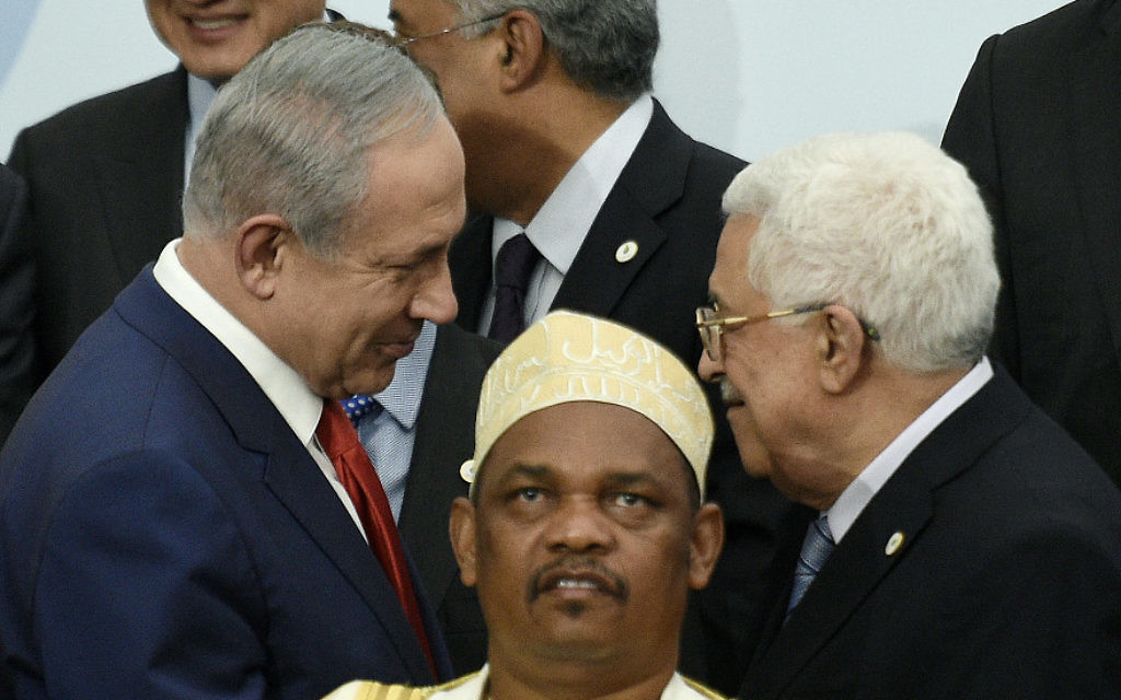 Israeli Prime Minister Benjamin Netanyahu, left, shaking hands with Palestinian Authority President Mahmoud Abbas. JTA