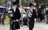 Illustrative image: Chasidic Jews walk down the street in Williamsburg, Brooklyn.
