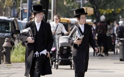 Illustrative image: Chasidic Jews walk down the street in Williamsburg, Brooklyn.