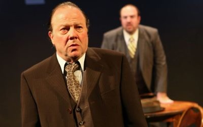 "Avi Hoffman as Willy Loman (foreground) and Adam Shapiro as Howard in ""Death of a Salesman."" Ronald L. Glassman"