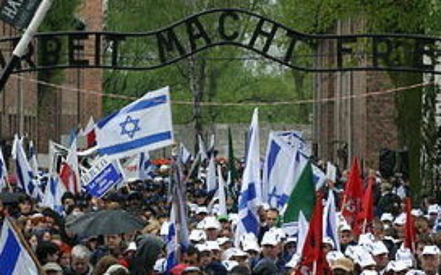 March of the Living participants at Auschwitz. Wikimedia Commons