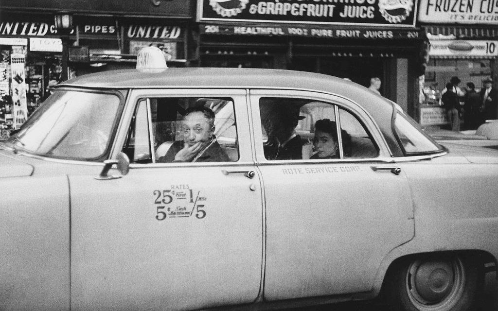 """Diane Arbus' """"Taxicab driver at the wheel with two passengers, N.Y.C."""" from 1956 ©The Estate of Diane Arbus, LLC. All Rights Reserved"""