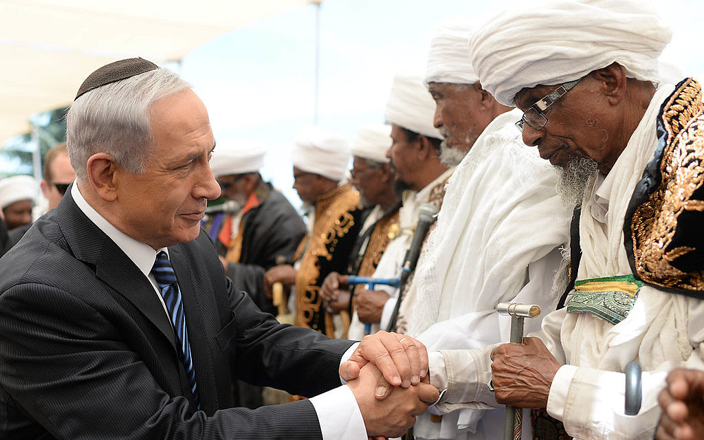 Israeli Prime Minister Benjamin Netanyahu shakes hands with religious leaders of the Ethiopian Jewish community. Getty Images